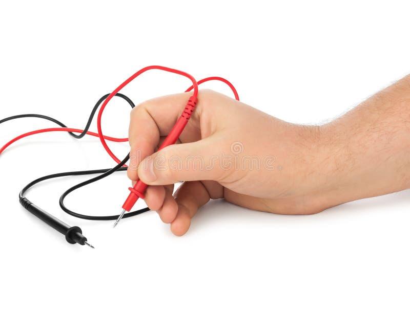 Рука и электрический вольтамперомметр стоковые изображения rf