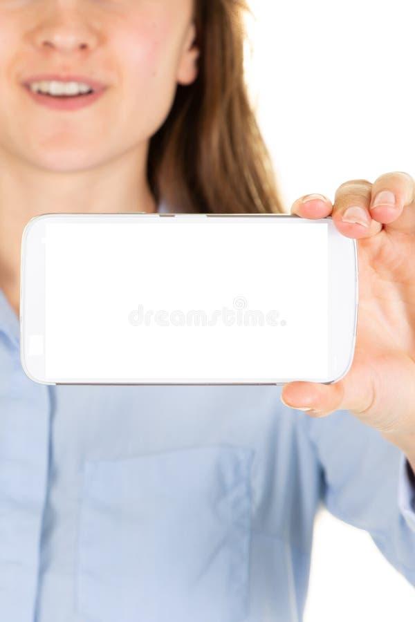 Рука молодой женщины держа современный модель-макет смартфона на бело стоковое изображение rf
