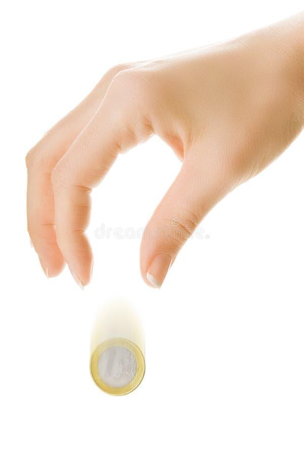 рука монеток падая стоковые изображения