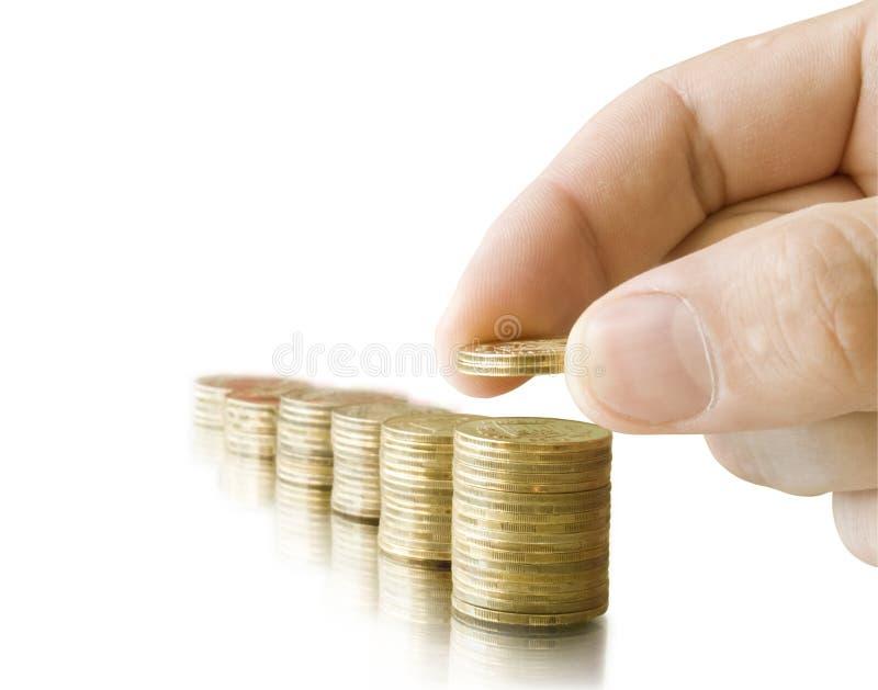 рука монеток стоковое изображение rf