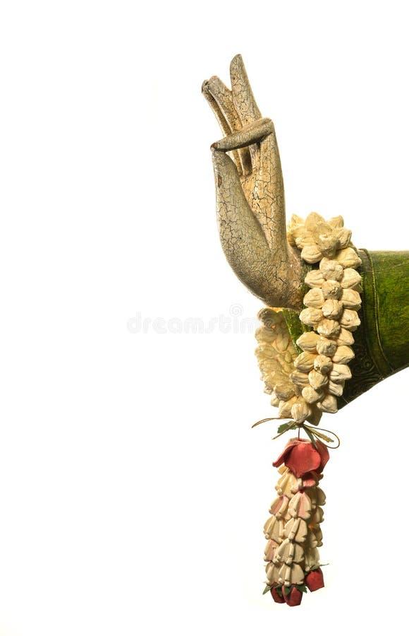 Рука натюрморта, Будды и цветок на белой предпосылке, стоковое фото rf