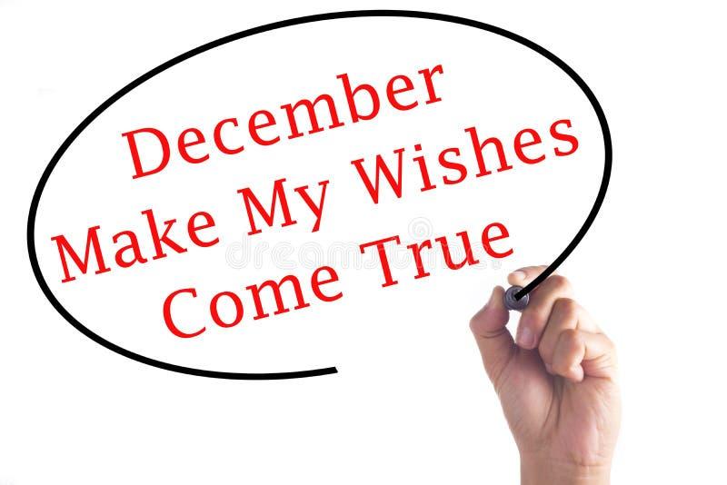 Рука писать декабрь делает мои желания прийти верно на прозрачном bo стоковое фото rf