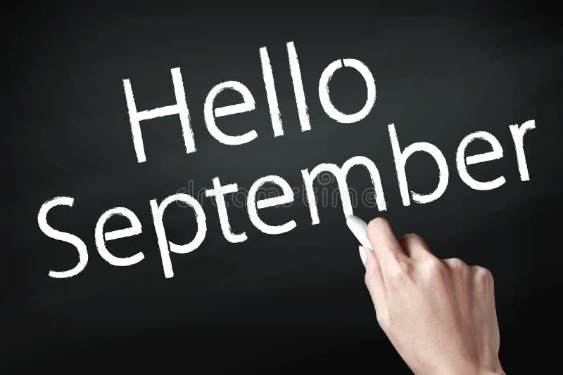Рука писать сентябрь стоковая фотография