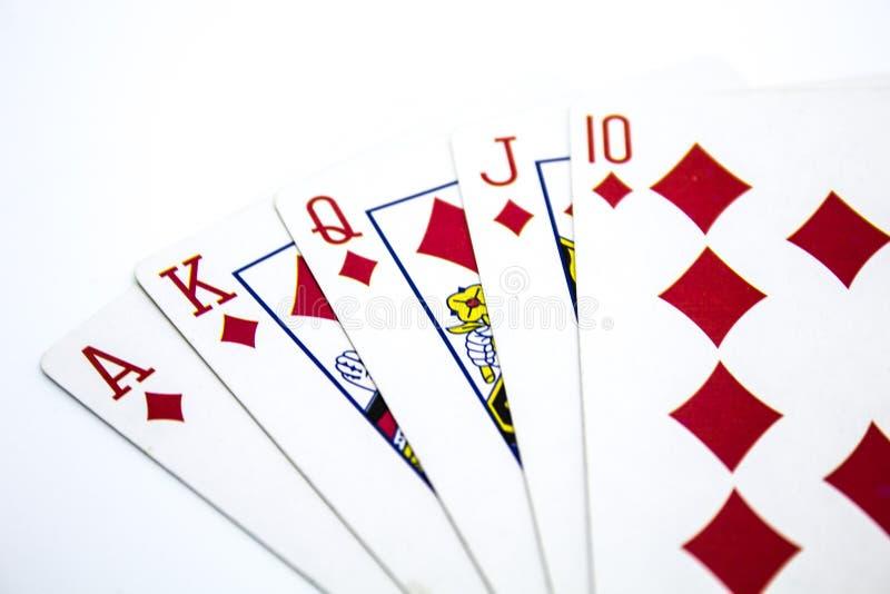 Рука покера королевского притока на белой предпосылке стоковая фотография rf