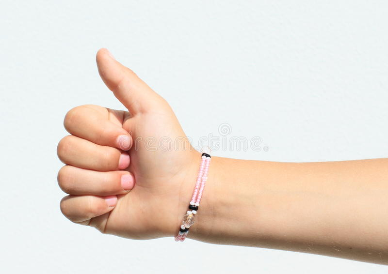 Рука ребенка - совсем справедливо стоковые фото