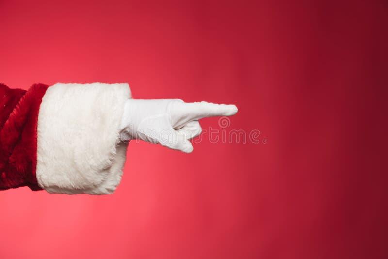Рука Санта Клауса указывая палец стоковая фотография