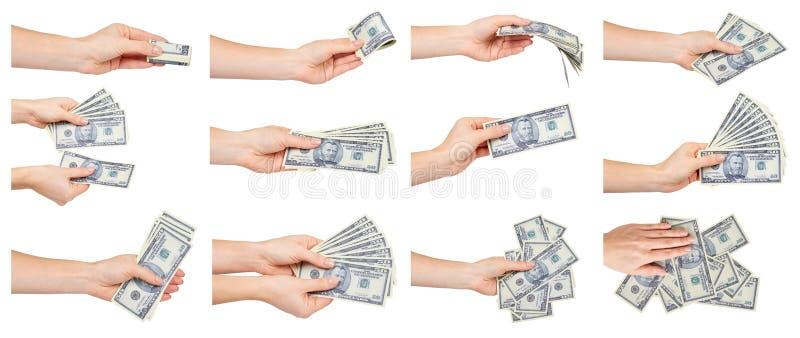 Рука с бумажными долларами США, американскими наличными деньгами, набором и собранием стоковое изображение