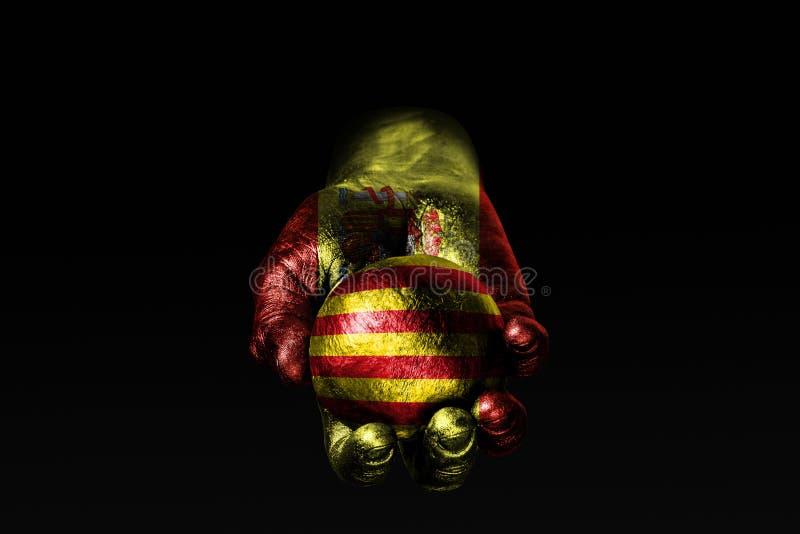 Рука с вычерченным флагом Испании держит шарик с вычерченным флагом Каталонии, знак влияния, давление или консервацию и стоковые изображения