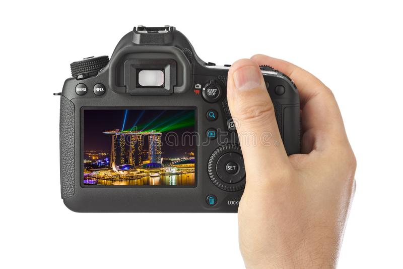 Рука с горизонтом камеры и города Сингапура мое фото стоковые изображения