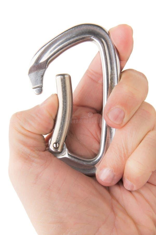 Рука с открытым Carabiner стоковые изображения