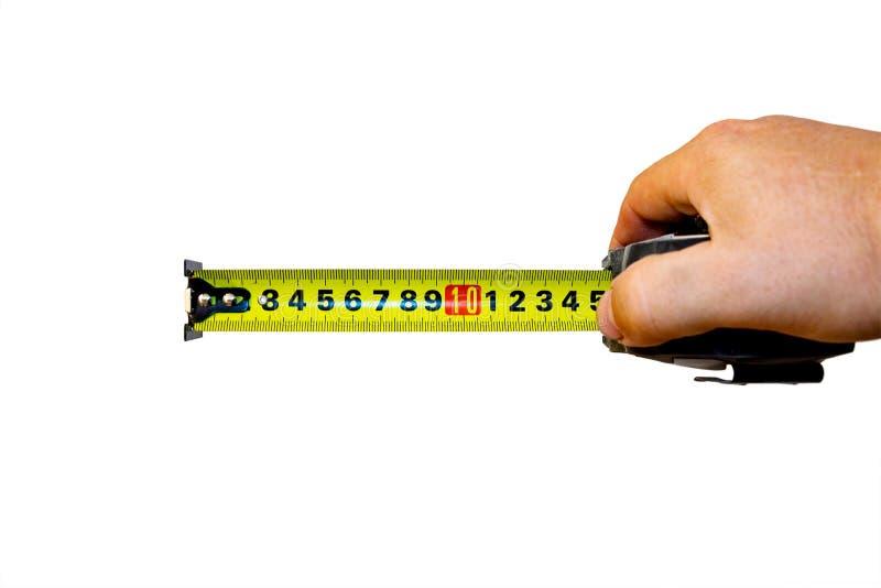 Рука с рулеткой на белизне стоковое изображение rf