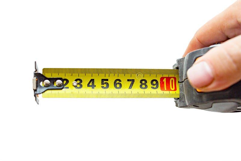 Рука с рулеткой на белизне стоковые фотографии rf
