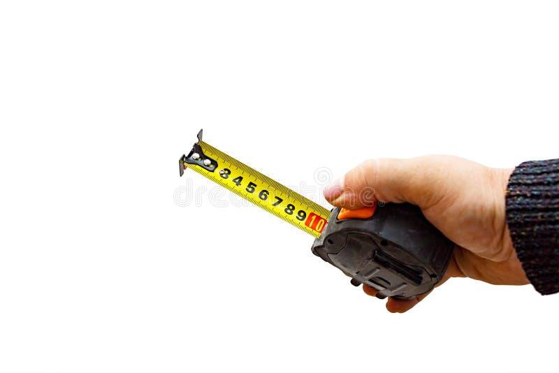 Рука с рулеткой на белизне стоковое изображение