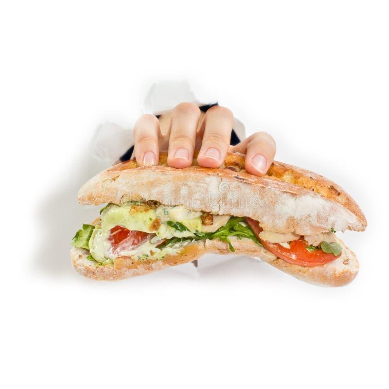 Рука с сандвичем стоковая фотография