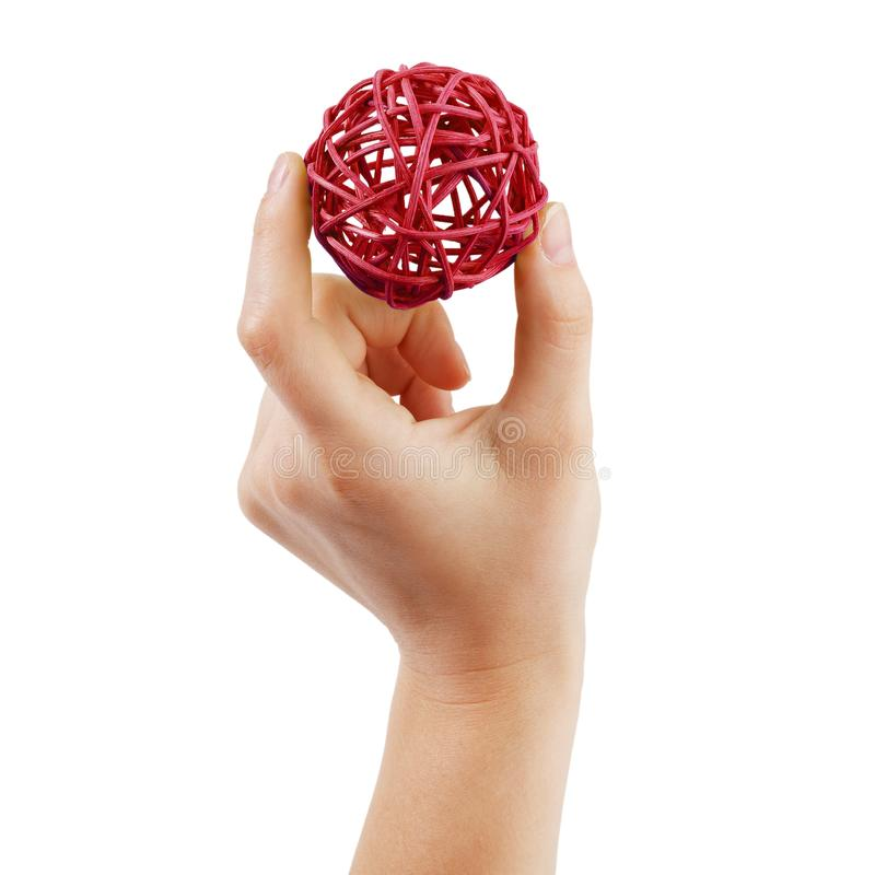 Рука с шариком сделанным ветвей стоковое фото