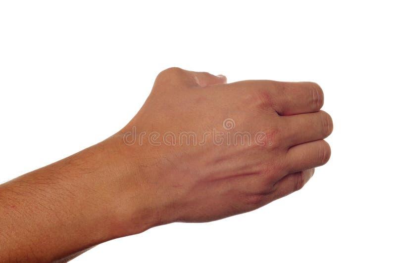 Рука человека держа что-то стоковое изображение rf