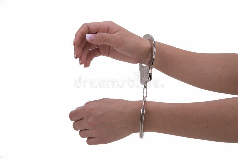 Рука ` s женщины с наручниками стоковая фотография rf
