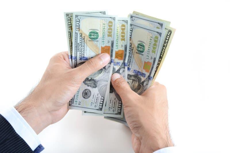 Руки бизнесмена подсчитывая деньги, счеты доллара США (USD) стоковые изображения