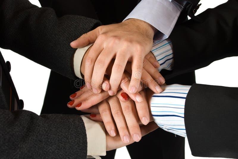 Руки бизнесменов показывая всеединство стоковое фото rf