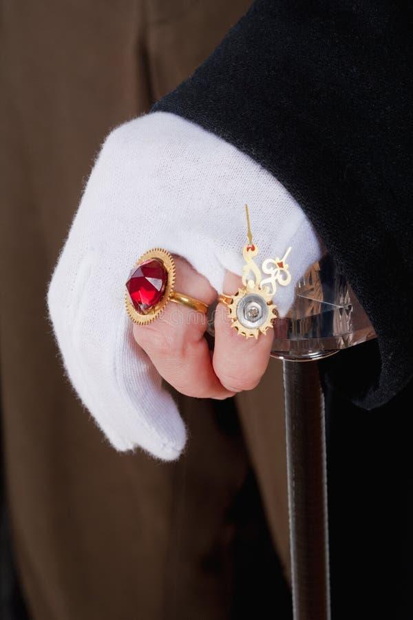 Руки волшебника с перчатками и кольцами стоковая фотография rf