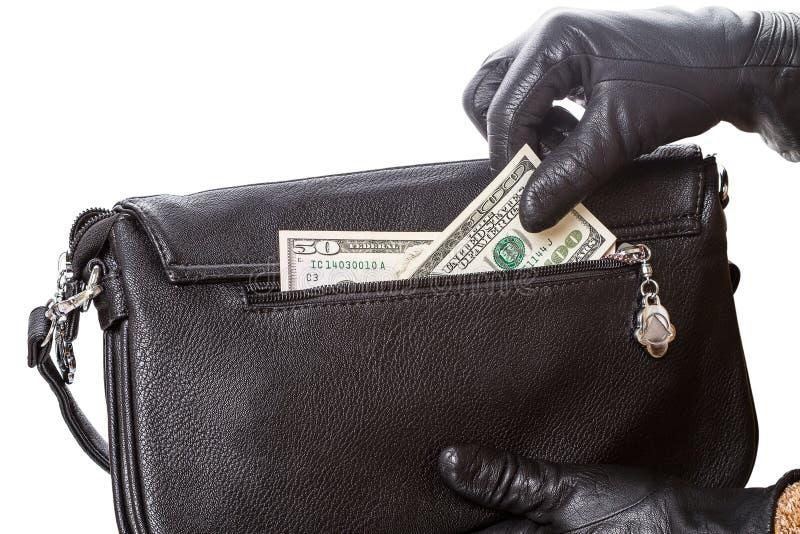 Руки в черных перчатках и долларах стоковая фотография rf