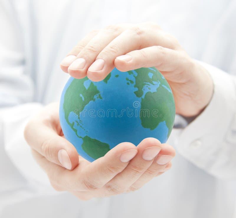руки глобуса стоковое фото rf