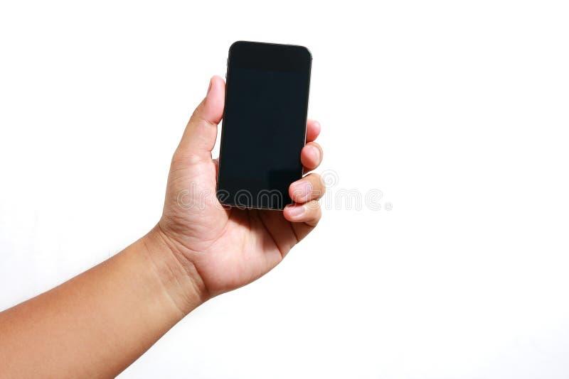Руки держа телефон стоковое фото rf