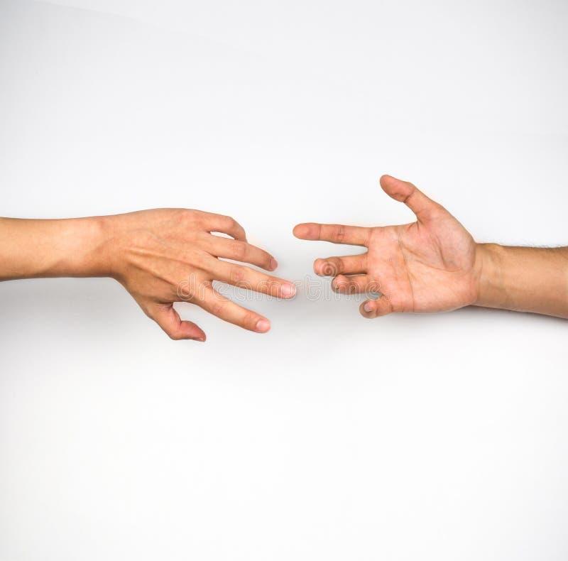 Руки достигая вне друг к другу стоковая фотография rf