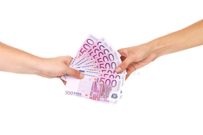 Руки держа 5 банкнот евро сотен. стоковая фотография