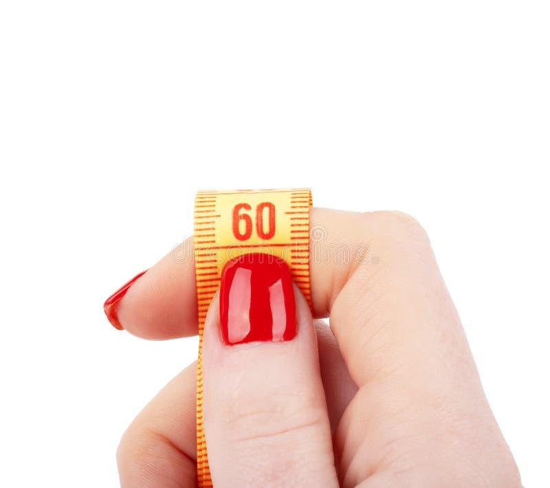 Руки женщины с лентой измерения изолированной на белой предпосылке стоковое изображение rf