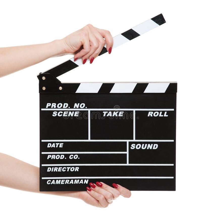 руки женщины clapboard кино стоковое изображение rf