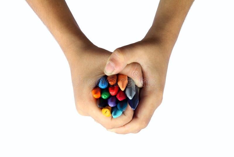 Руки и Crayons стоковая фотография