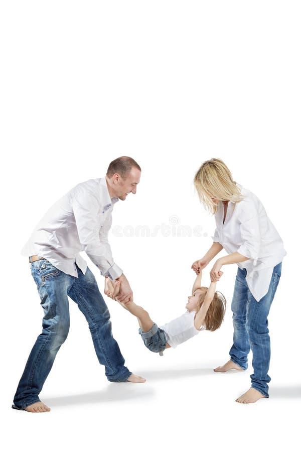 руки ног отца дочи держат мать стоковая фотография