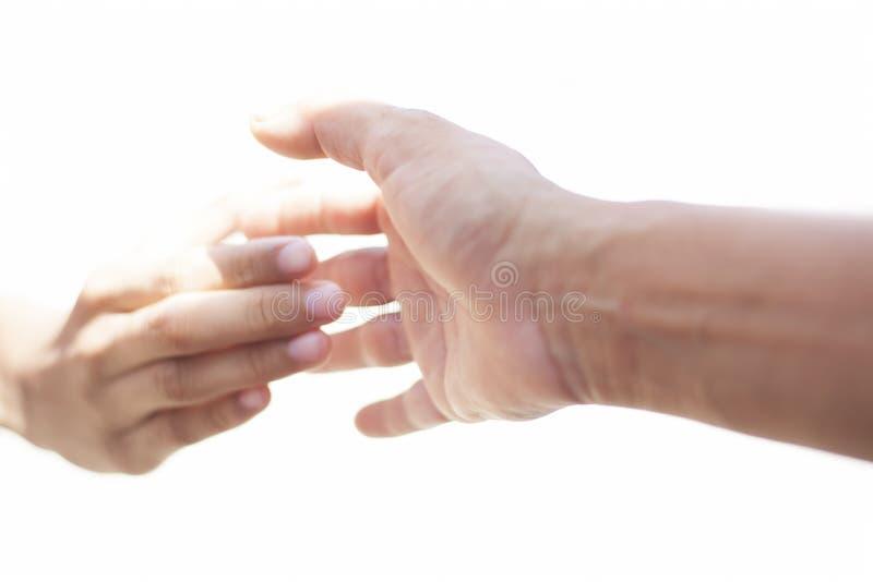 Руки помощи изолированные на белизне стоковые изображения rf