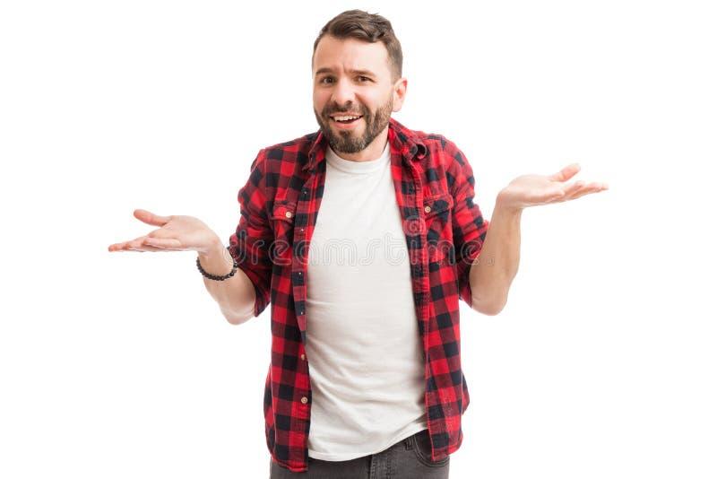 Руки человека Shrugging и распространяя стоковое изображение rf