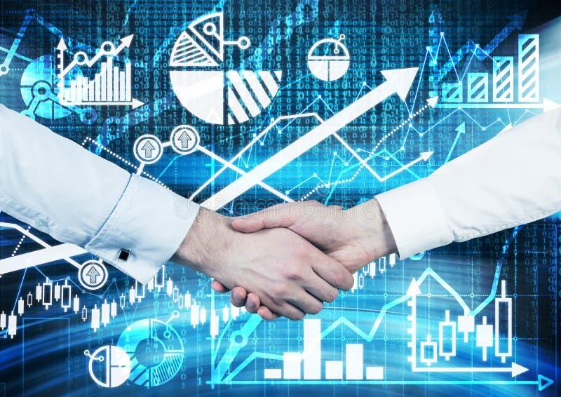 Рукопожатие над цифровым экраном с диаграммами и диаграммами стоковая фотография rf