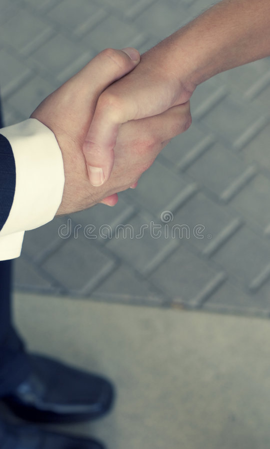 рукопожатие 8 дел стоковое фото rf