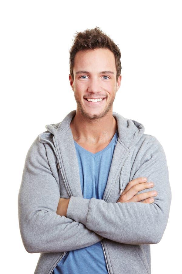 рукоятки пересекли счастливый усмехаться человека стоковое фото