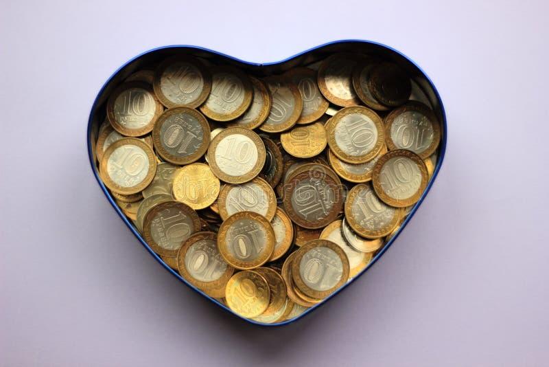 Русские деньги в копилке стоковое фото