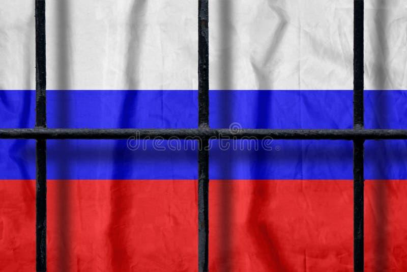 Русский флаг за черными барами тюрьмы металла с тенями стоковое фото rf