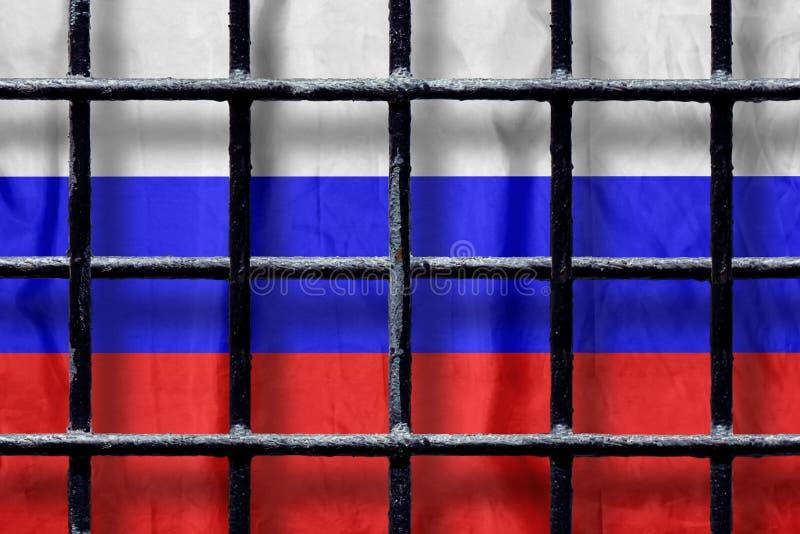 Русский флаг за черными барами тюрьмы металла с тенями стоковые изображения rf