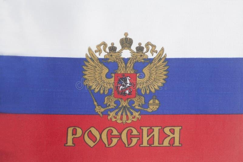 Русский флаг с эмблемой России стоковые изображения