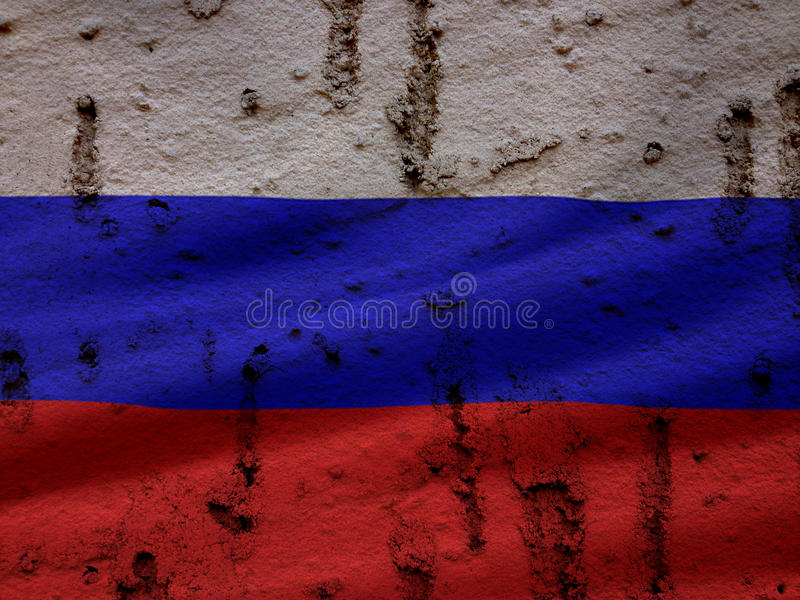 Русский флаг на предпосылке стены Grunge стоковые изображения rf