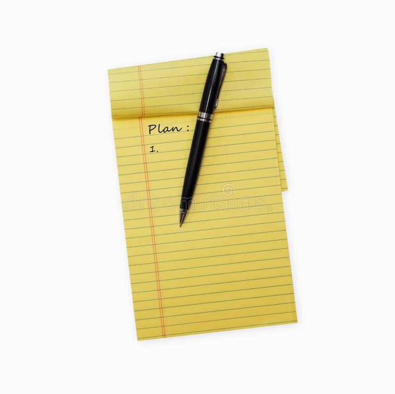Ручка кладя на раскрытый блокнот стоковые фото
