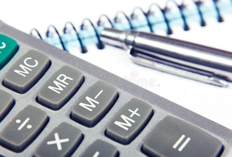 Ручка с калькулятором и тетрадью стоковое фото