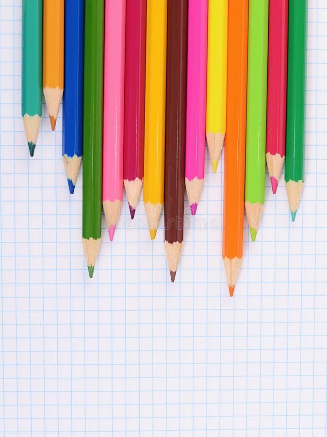 Ручка цвета на бумаге с тетрадью стоковое фото rf