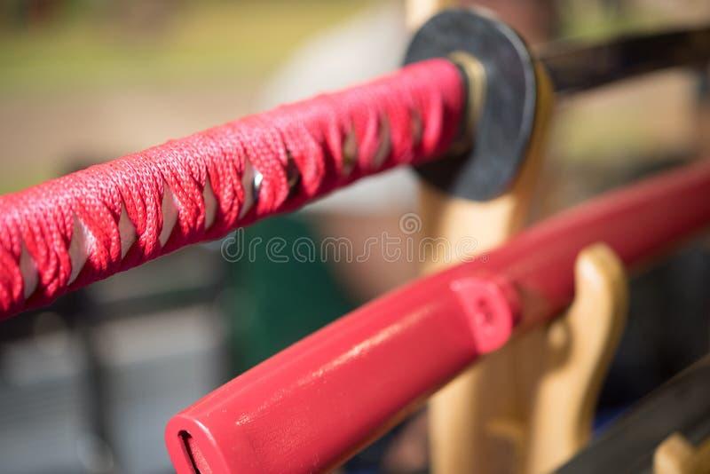 Ручка шпаги самурая красная стоковое изображение