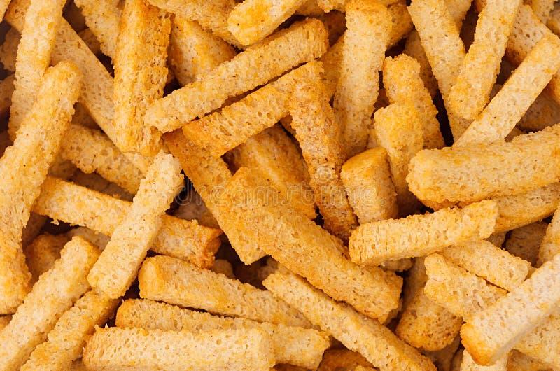 Ручки гренков пшеницы желтые как предпосылка Текстура закусок пива стоковое изображение rf