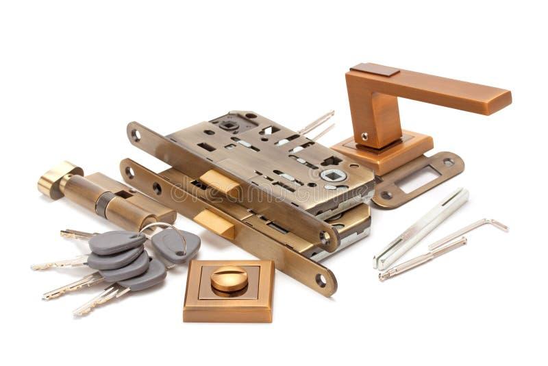 Ручки, замки и ключи двери стоковые изображения