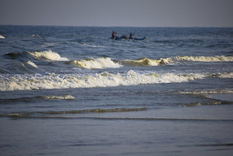Рыбацкая лодка над морем стоковое фото rf